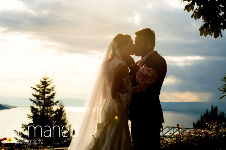 silhouetted shot of wedding couplein front of stunning view down lac leman at Fairmont Le Montreux Palace, Lake Geneva wedding by Gill Maheu Photography, photographe de mariage