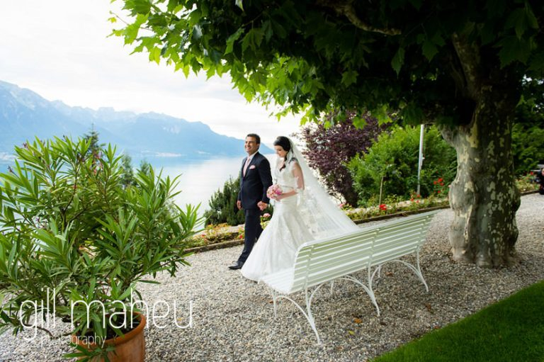 wedding couple walking trough gardens at Fairmont Le Montreux Palace, Lake Geneva wedding by Gill Maheu Photography, photographe de mariage