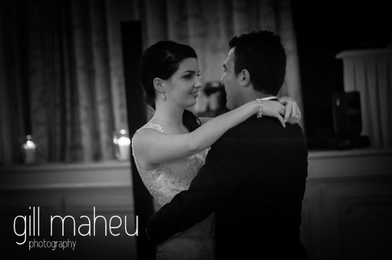 black and white photo of bride and groom's first dance in wedding in the Belle Epoque Ballroom at Fairmont Le Montreux Palace, Lake Geneva wedding by Gill Maheu Photography, photographe de mariagebride and