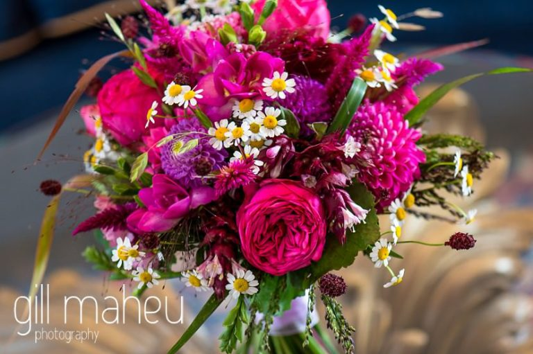 stunning cerise pink wedding bouquet at the Auberge du Raisin before Chateau de Glérolles, Lausanne, Lake Geneva wedding by Gill Maheu Photography, photographe de mariage