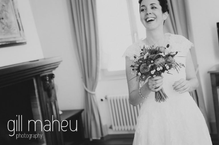 black and white portrait of beautiful bride laughing in the Auberge du Raisin before Chateau de Glérolles, Lausanne, Lake Geneva wedding by Gill Maheu Photography, photographe de mariage