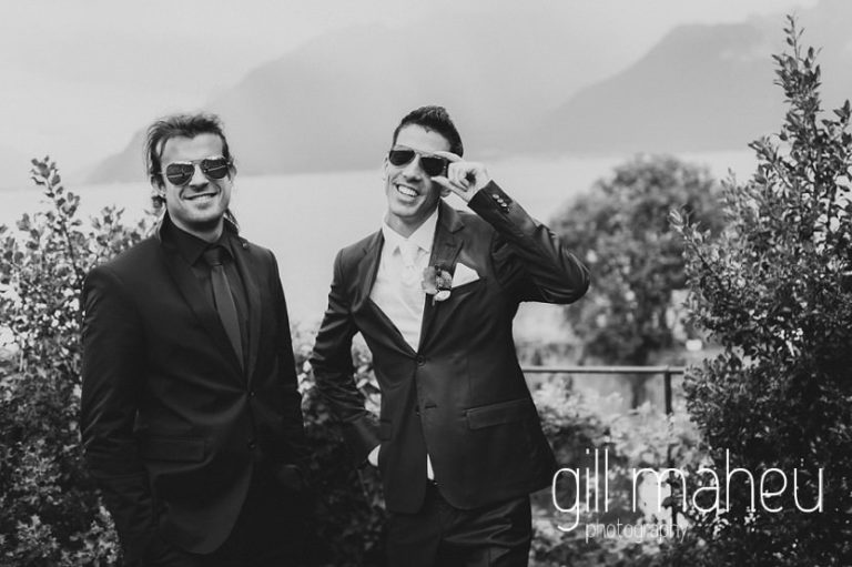 black and white of groom and best man having fun at Chateau de Glérolles, Lausanne, Lake Geneva wedding by Gill Maheu Photography, photographe de mariage
