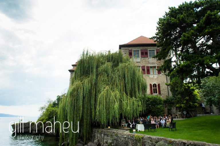 view of the gardens and wedding congregation waiting for the arrival of the bride at Chateau de Glérolles, Lausanne, Lake Geneva wedding by Gill Maheu Photography, photographe de mariage