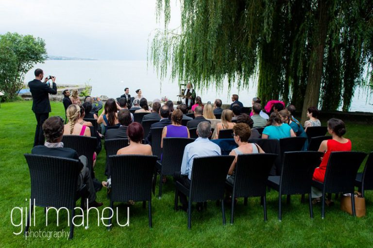 photo of congregation in the grounds of Chateau de Glérolles, Lausanne, Lake Geneva wedding by Gill Maheu Photography, photographe de mariage