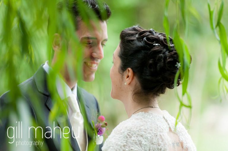 bride and groom enjoy a moment during their wedding ceremony in the gardens of Chateau de Glérolles, Lausanne, Lake Geneva wedding by Gill Maheu Photography, photographe de mariage