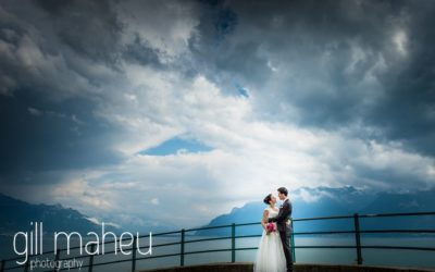wedding couple in wide angle portrait of stormy clouds over lac Leman at Chateau de Glérolles, Lausanne, Lake Geneva wedding by Gill Maheu Photography, photographe de mariage