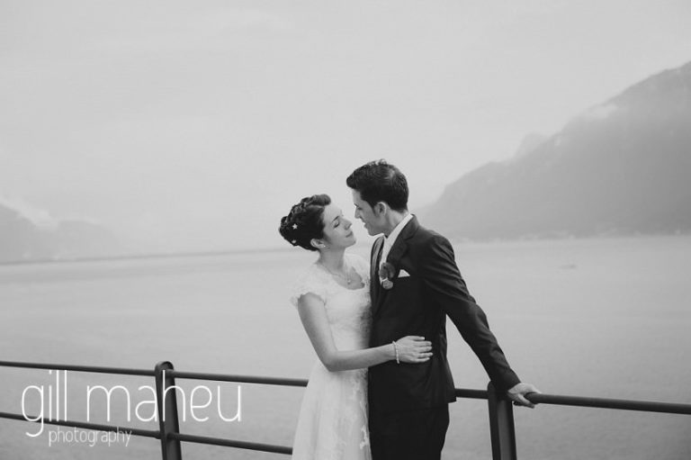 black and white photo of bride and groom silhouetted against lac léman at Chateau de Glérolles, Lausanne, Lake Geneva wedding by Gill Maheu Photography, photographe de mariage