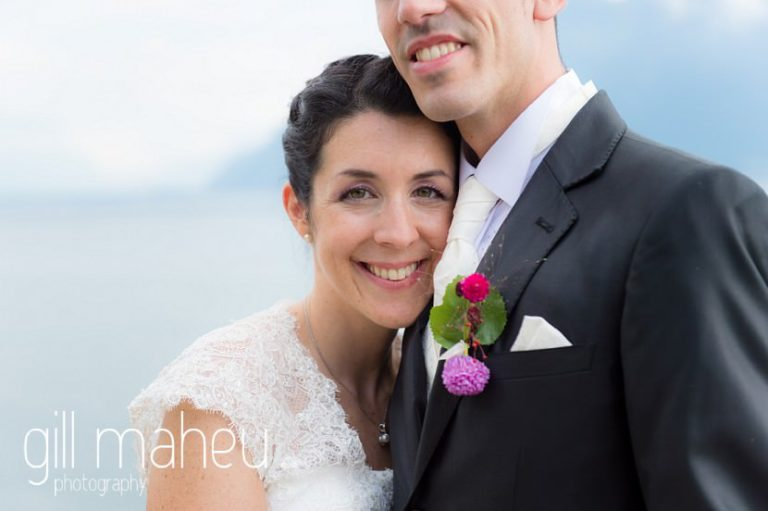 smiling happy bride with her head resting on groom's chest at Chateau de Glérolles, Lausanne, Lake Geneva wedding by Gill Maheu Photography, photographe de mariage