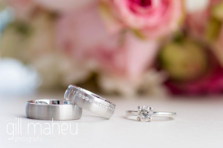 close up detail shots of diamond wedding rings in front of rose bouquet at St Saphorin, Lake Geneva wedding by Gill Maheu Photography, photographe de mariage