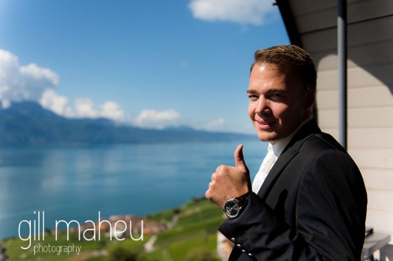 portrait of groom getting ready and admiring the view at Hotel Pré Alpina before St Saphorin, Lake Geneva wedding by Gill Maheu Photography, photographe de mariage