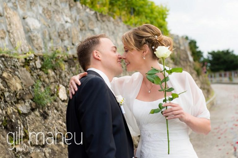 bride and groom kissing at first look in the vineyards above Lutry at St Saphorin, Lake Geneva wedding by Gill Maheu Photography, photographe de mariage