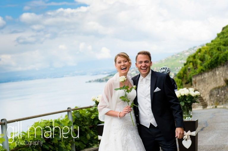 bride and groom smiling at first look in the vineyards above Lutry at St Saphorin, Lake Geneva wedding by Gill Maheu Photography, photographe de mariage