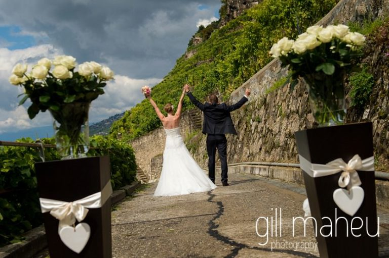bride and groom celebrating walking away from the camera at first look in the vineyards above Lutry at St Saphorin, Lake Geneva wedding by Gill Maheu Photography, photographe de mariage
