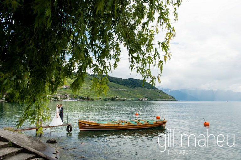 bride and groom walking along Lac Leman shore in lutry before St Saphorin, Lake Geneva wedding by Gill Maheu Photography, photographe de mariage