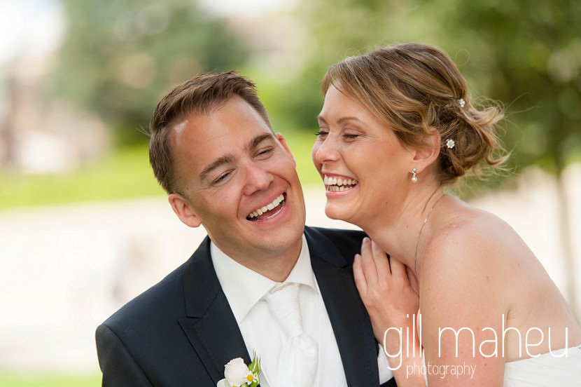 close up of bride and groom laughing together at St Saphorin, Lake Geneva wedding by Gill Maheu Photography, photographe de mariage
