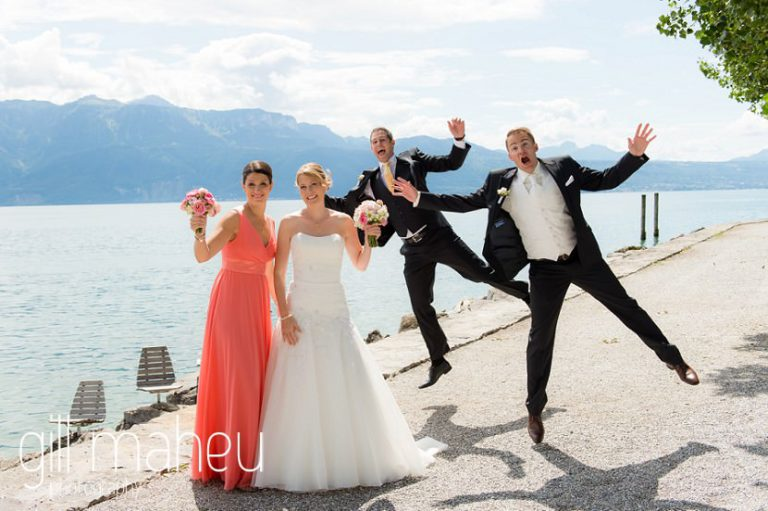 bridal party of bride groom and their temoins jumping for joy on the lakeside at Lutry before St Saphorin, Lake Geneva wedding by Gill Maheu Photography, photographe de mariage