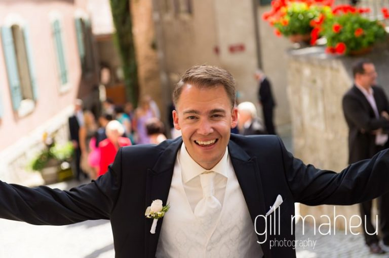 groom celebrating after wedding ceremony at St Saphorin church , Lake Geneva wedding by Gill Maheu Photography, photographe de mariage