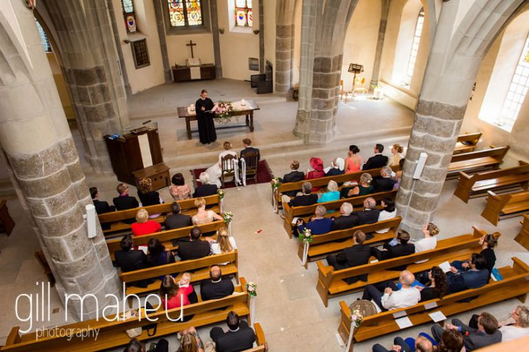 view of the congregation in the church at St Saphorin, Lake Geneva wedding by Gill Maheu Photography, photographe de mariage
