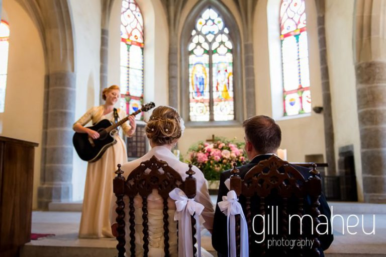 guitar soloist in church ceremony at St Saphorin, Lake Geneva wedding by Gill Maheu Photography, photographe de mariage