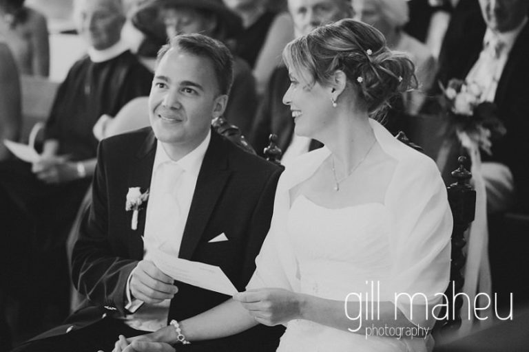 black and white of bride and groom during wedding ceremony in Eglise de St Saphorin at Lake Geneva wedding by Gill Maheu Photography, photographe de mariage