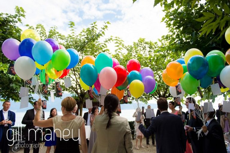 preparing for colourful vin d'honneur cocktail balloon release at St Saphorin, Lake Geneva wedding by Gill Maheu Photography, photographe de mariage