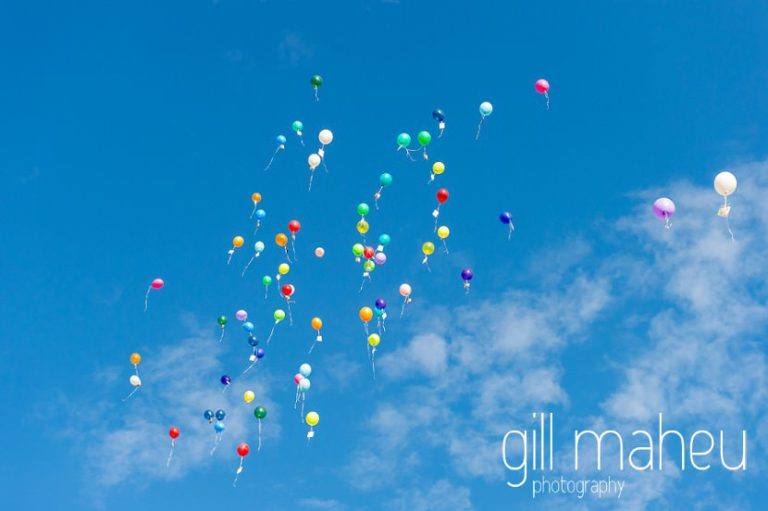 colourful vin d'honneur cocktail balloon release at St Saphorin, Lake Geneva wedding by Gill Maheu Photography, photographe de mariage