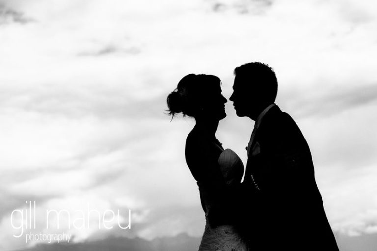 black and white portrait of bride and groom silhouetted against evening sky at St Saphorin, Lake Geneva wedding by Gill Maheu Photography, photographe de mariage