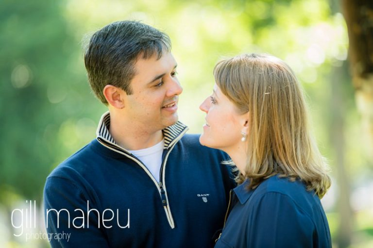 portrait of couple smiling at each other in the gardens of Le Paquier on lifestyle photo session in the Vielle Ville of Annecy by Gill Maheu Photography, photographe de mariage et de famille