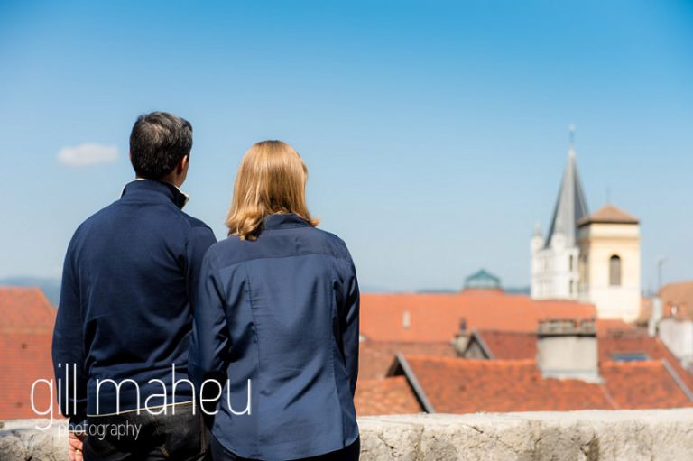 back shot of couple looking out over the Vielle Ville of Annecy by Gill Maheu Photography, photographe de mariage et de famille