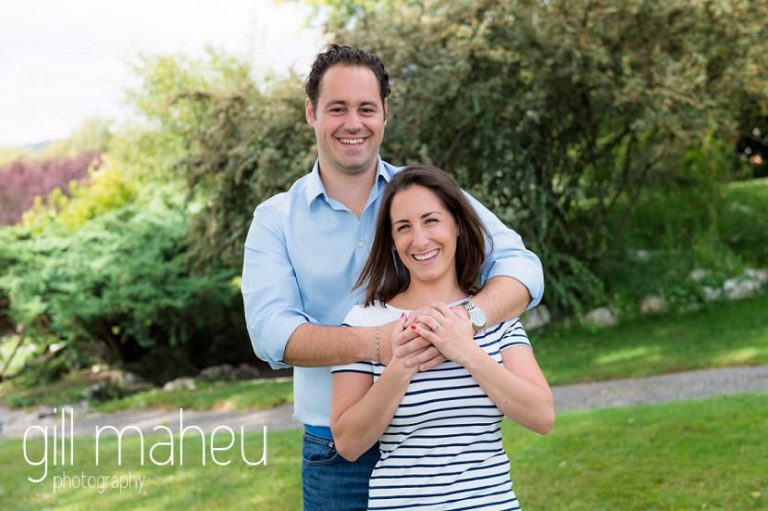 close up portrait of future bride in her husbands arms in park on Divonne, Geneva engagement session by Gill Maheu Photography, photographe de mariage
