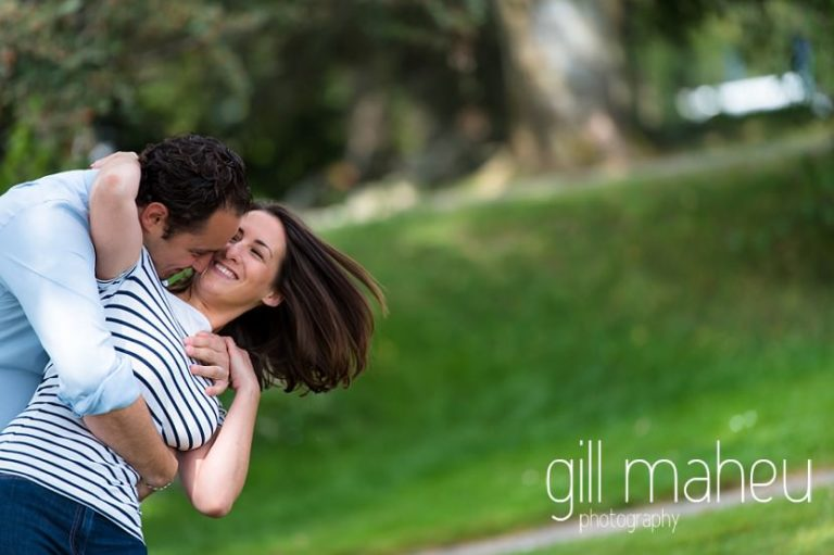 engaged couple practising their first dance dip in park on Divonne, Geneva engagement session by Gill Maheu Photography, photographe de mariage