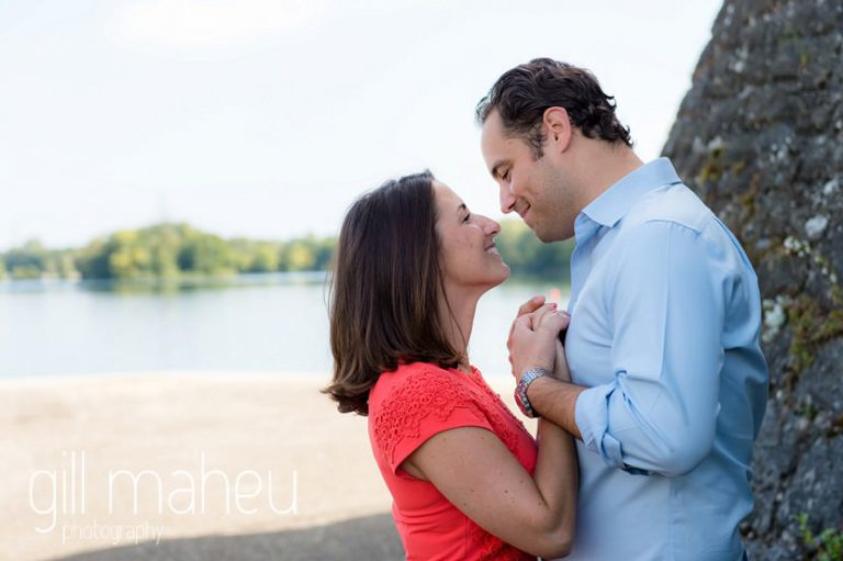 future bride and groom face to face in front of lake on Divonne, Geneva engagement session by Gill Maheu Photography, photographe de mariage