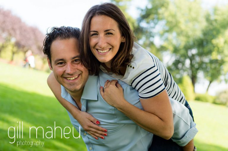 future bride laughing on groom's back on Divonne, Geneva engagement session by Gill Maheu Photography, photographe de mariage