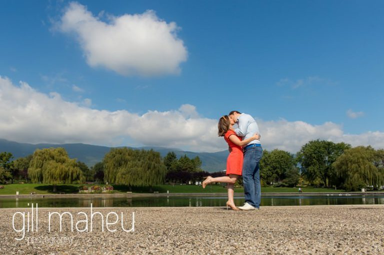 engaged couple practising their first dance in front of lake on Divonne, Geneva engagement session by Gill Maheu Photography, photographe de mariage