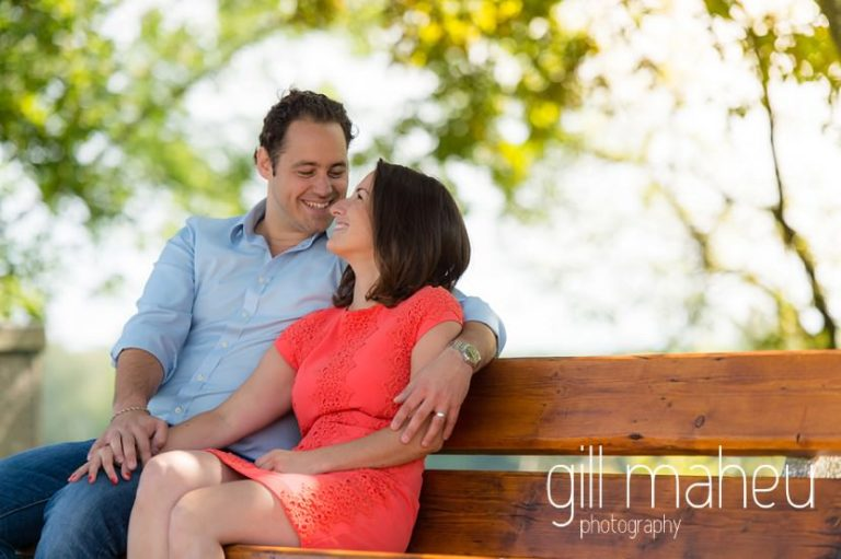 bride and groom chatting to each other on beanch in parc on Divonne, Geneva engagement session by Gill Maheu Photography, photographe de mariage