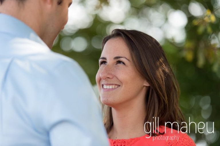 close up of future bride smiling up at her husband to be on Divonne, Geneva engagement session by Gill Maheu Photography, photographe de mariage