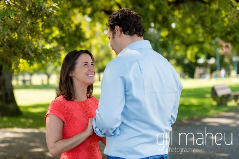 future bride smiling up at her husband to be on Divonne, Geneva engagement session by Gill Maheu Photography, photographe de mariage