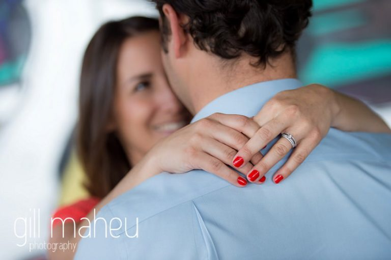 bride smiling at her groom to be on Divonne, Geneva engagement session by Gill Maheu Photography, photographe de mariage