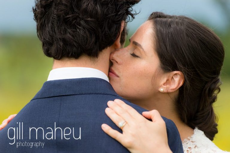 bride kissing groom's cheek on Geneva love the dress day after session by Gill Maheu Photography, photographe de mariage