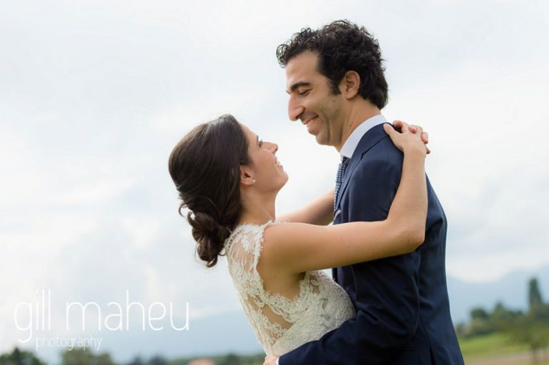 bride and groom embracing on Geneva love the dress day after session by Gill Maheu Photography, photographe de mariage