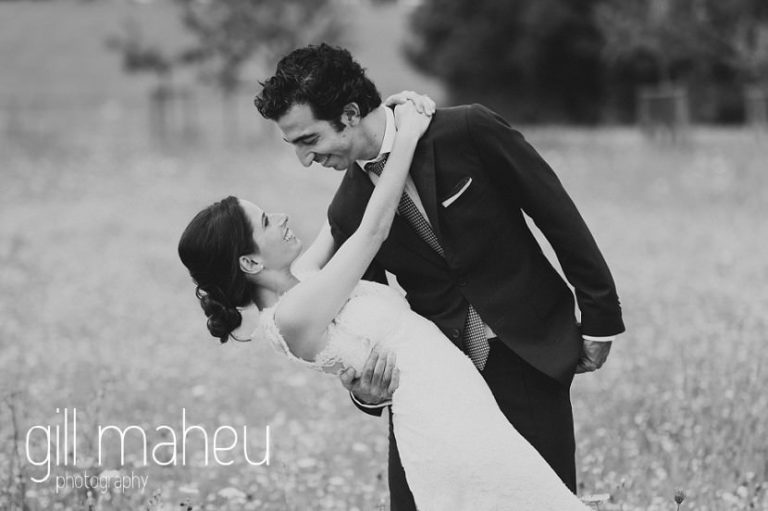 black and white photo of wedding couple dancing on Geneva love the dress day after session by Gill Maheu Photography, photographe de mariage