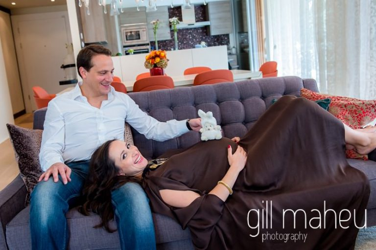 portraits of future parents lying on the sofa in maternity session in Geneva, by Gill Maheu Photography, photographe de Grossesse et lifestyle