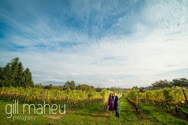 wide angle of future parents in vineyards at maternity session in Collonges, Geneva, by Gill Maheu Photography, photographe de Grossesse et lifestyle