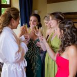 bride and bridesmaids enjoying champagne during bridal preparations at Abbaye de Talloires, Lake Annecy wedding by Gill Maheu Photography, photographe de mariage