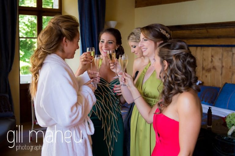 bride and bridesmaids enjoying champagne during bridal preparations at Abbaye de Talloires, Lake Annecy wedding by Gill Maheu Photography, photographe de mariage