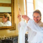 bride looking at wedding dress in Abbaye de Talloires, Lake Annecy wedding by Gill Maheu Photography, photographe de mariage
