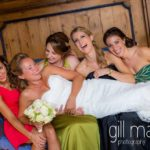 bride laughing with her bridesmaids in bridal preparations in suite nuptiale Jean Reno at Abbaye de Talloires, Lake Annecy wedding by Gill Maheu Photography, photographe de mariage