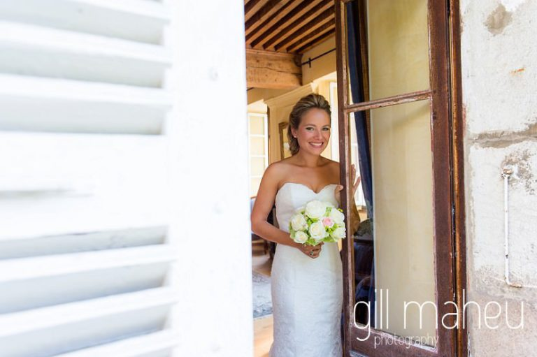 portrait of bride looking through the windows at Abbaye de Talloires, Lake Annecy wedding by Gill Maheu Photography, photographe de mariage