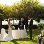 bride and groom exchanging vows at outdoor wedding ceremony in the gardens of the Abbaye de Talloires, Lake Annecy wedding by Gill Maheu Photography, photographe de mariage