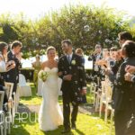 bride and groom leaving wedding ceremony under bubble confetti at Abbaye de Talloires, Lake Annecy wedding by Gill Maheu Photography, photographe de mariage